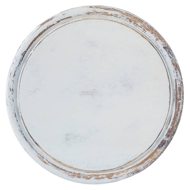 Distressed, worn, weathered, old, white-painted circular wooden panel abstract background. stock photo