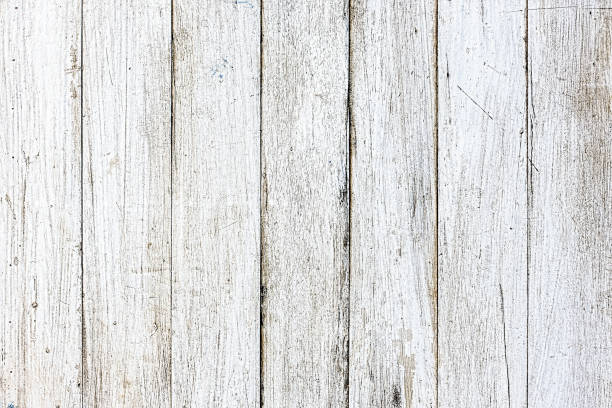 Distressed, worn, weathered, old, white-painted wooden panel abstract table background. stock photo