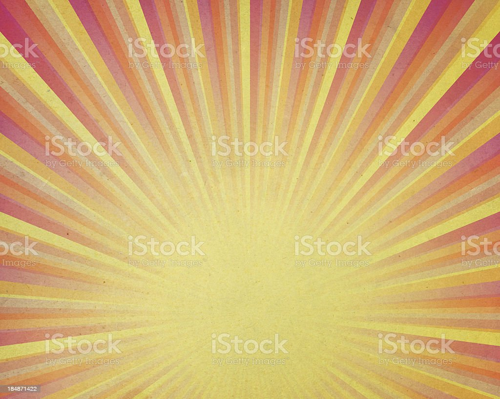 distressed yellow paper with light rays stock photo