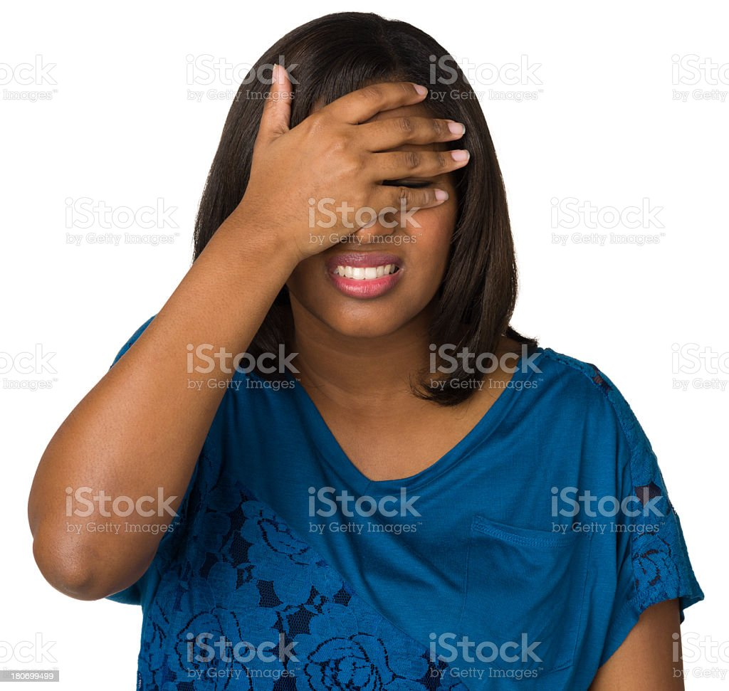 Distressed Young Woman Covering Eyes royalty-free stock photo