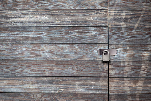 distrested aged wood wall and gate with hing latch and bolt lock background materal surface
