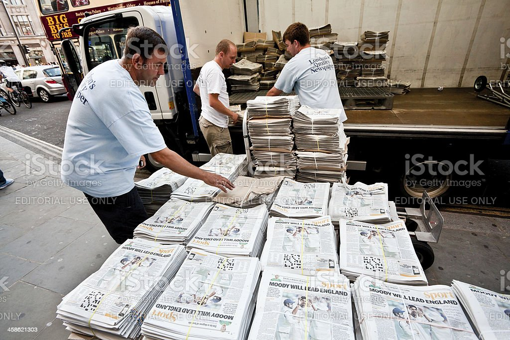 Distributing The Evening Standard in London stock photo