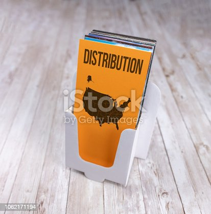 istock Distribution across the USA, leaflet holder with map 1062171194