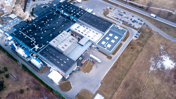 Distribution Center and logistics warehouse for manufacturer retailer logistics. Aerial Distribution Center and logistics warehouse for manufacturer retailer logistics. Aerial distribution center stock pictures, royalty-free photos & images