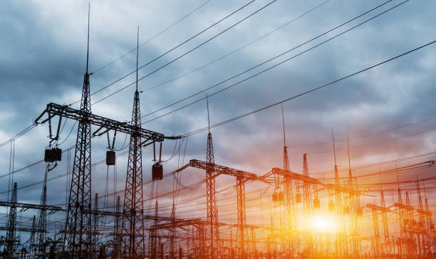 distribution electric substation with power lines and transformers - rete elettrica foto e immagini stock