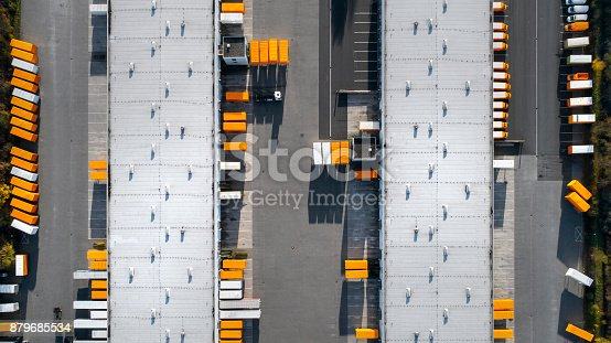 istock Distribution logistics building parking lot - aerial view 879685534