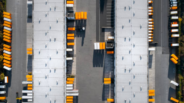 Distribution logistics building parking lot - aerial view stock photo