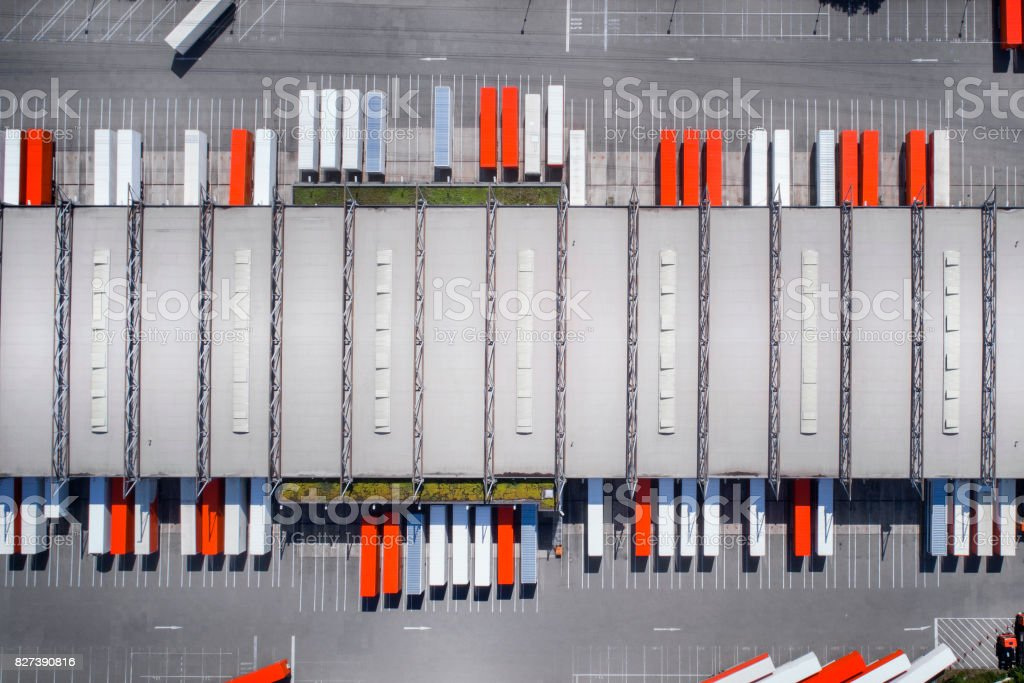 Distribution logistics building parking lot stock photo