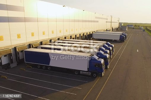 distribution warehouse with trucks awaiting loading.