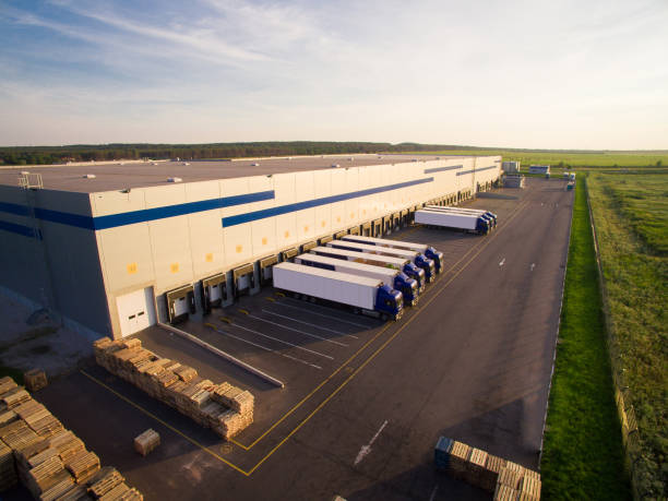 distribution warehouse with trucks of different capacity - warehouse stock photos and pictures