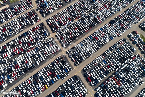 istock Distribution yard with new cars of different brands 1048125460