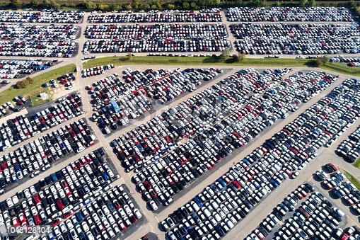 istock Distribution yard with new cars of different brands 1048126404