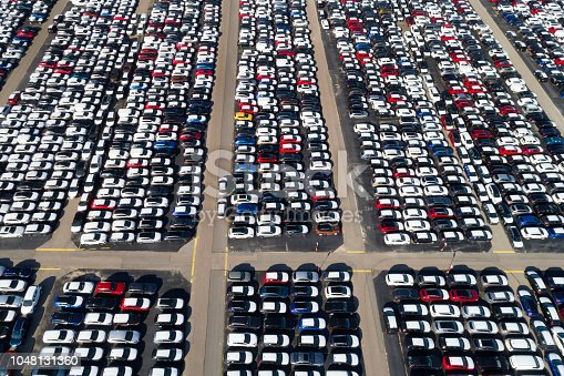 istock Distribution yard with new cars of different brands 1048131360