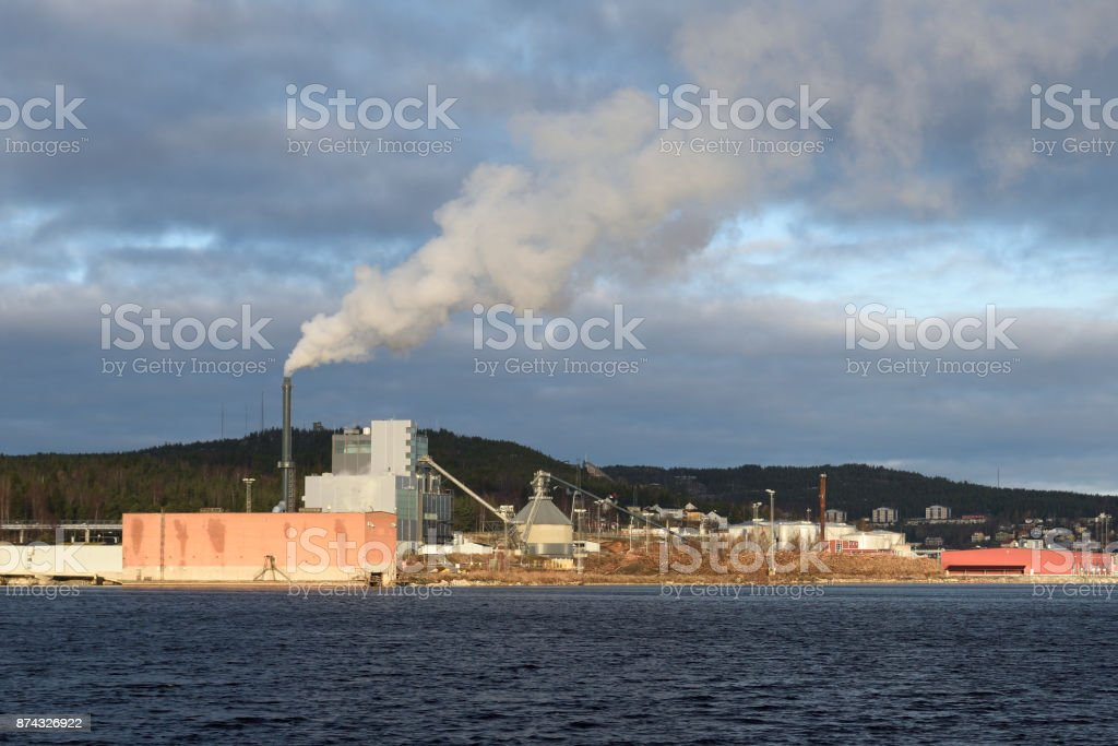 District heating plant with lot of smoke comming out of chimney stock photo
