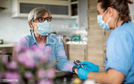 istock District nurse at home visit 1225860730