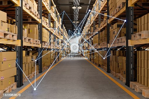 istock Distrubution Warehouse With Plexus. Remote Control With Mobile App And Technology Devices. 1323983873