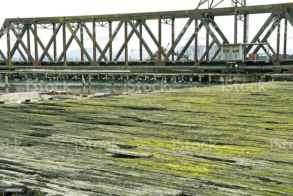 Disused dock and railroad swing bridge in Washington state royalty-free stock photo