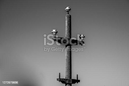 long abandoned concrete power pylon