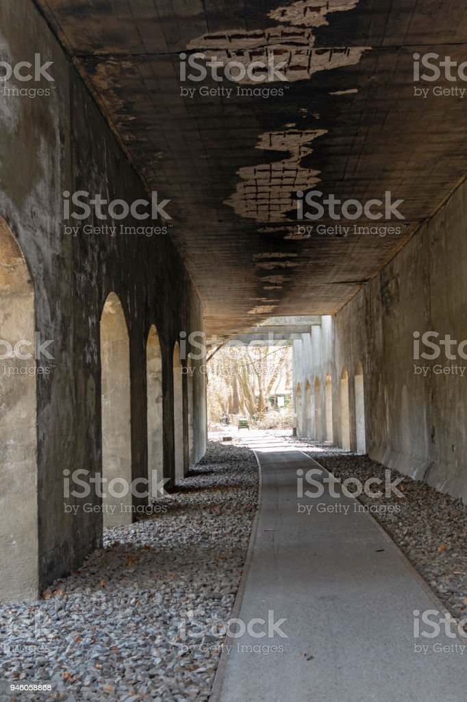Disused railway underpass of a former rail yard in Berlin, which is now used as a footpath stock photo