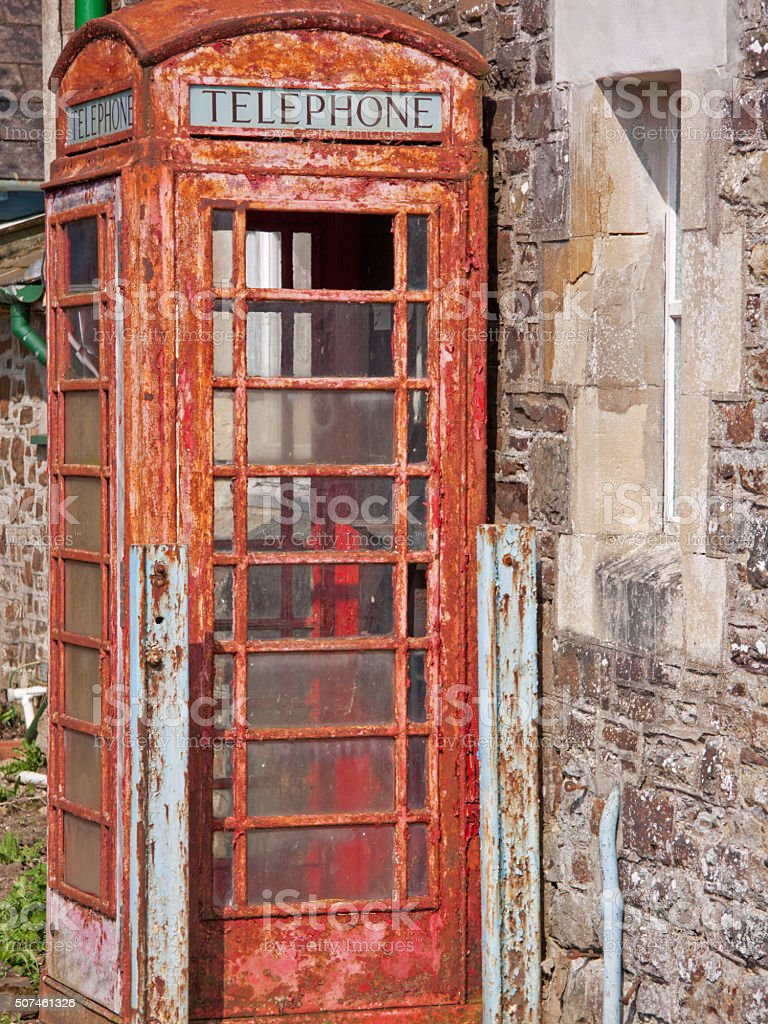 Disused traditional red telephone box UK stock photo