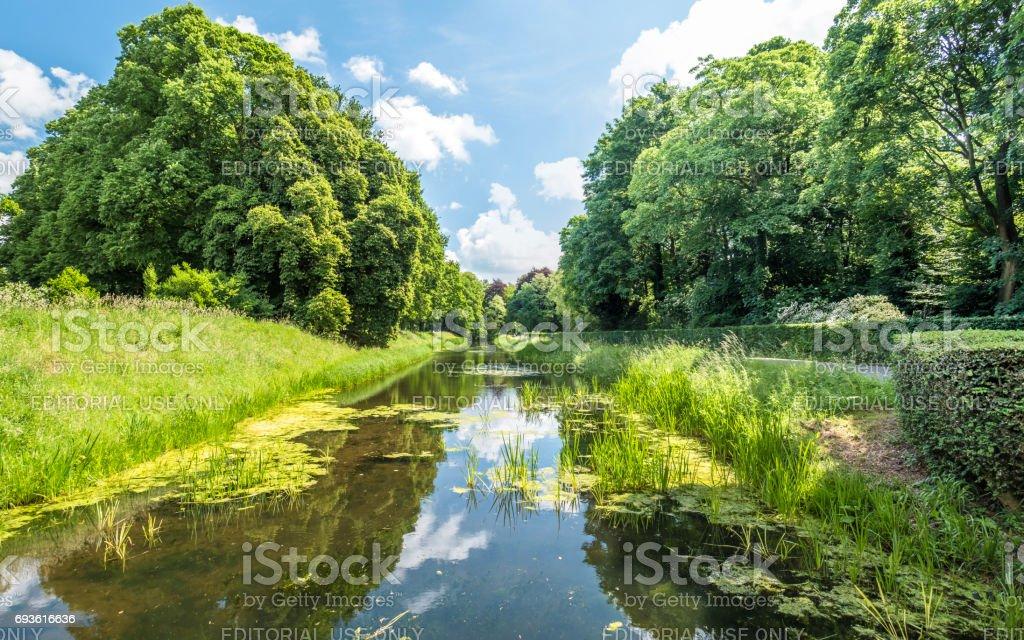 Ditch around the medieval castle De Haar in Netherlands stock photo