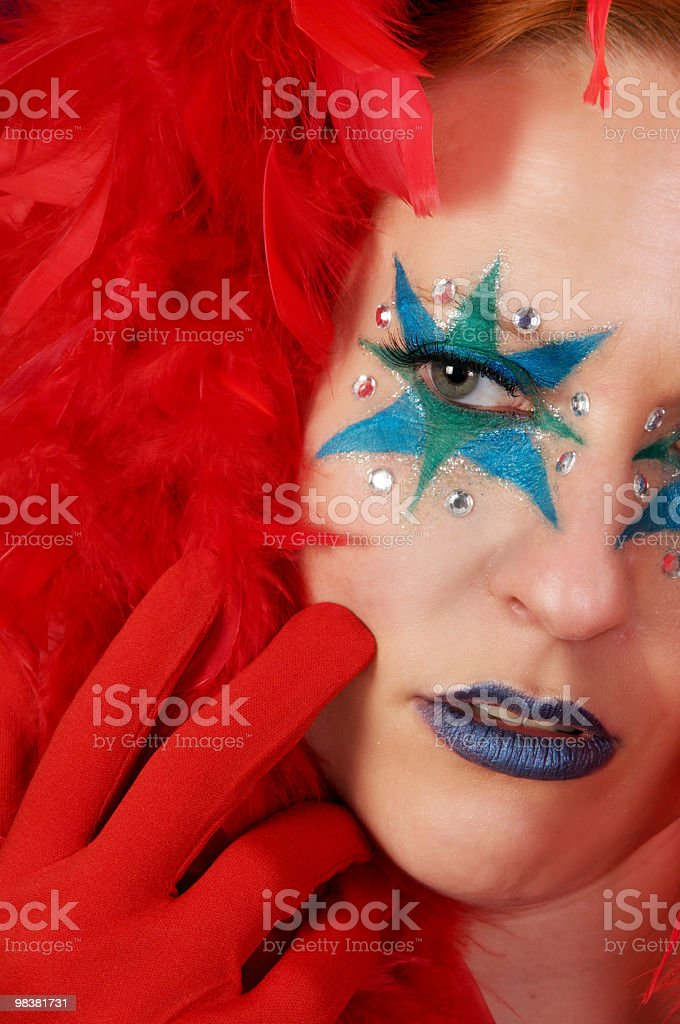 Diva touches face with red glove'ed hand. royalty-free stock photo