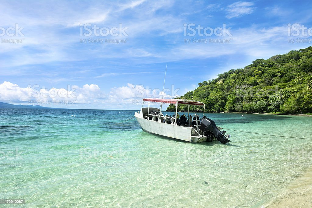 Dive boat in tropical bay royalty-free stock photo