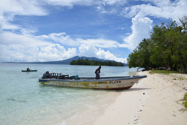 Dive boat on the beach at a pretty island in Roviana Lagoon, Munda, Solomon Islands