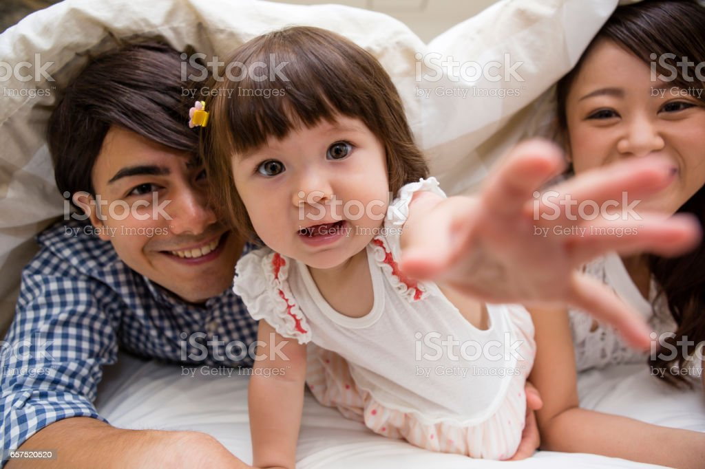 Dive into the futon in family stock photo