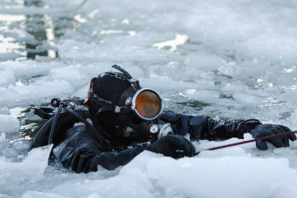 Diver among the ice stock photo