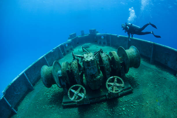 diver and shipwreck in cayman islands - artificial reef stock pictures, royalty-free photos & images