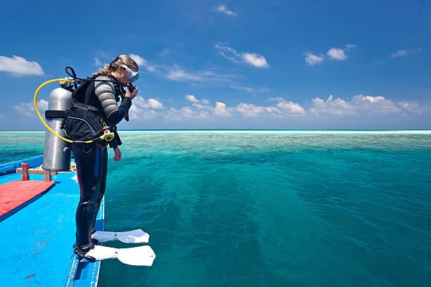 Plongeur de l'eau en bateau - Photo