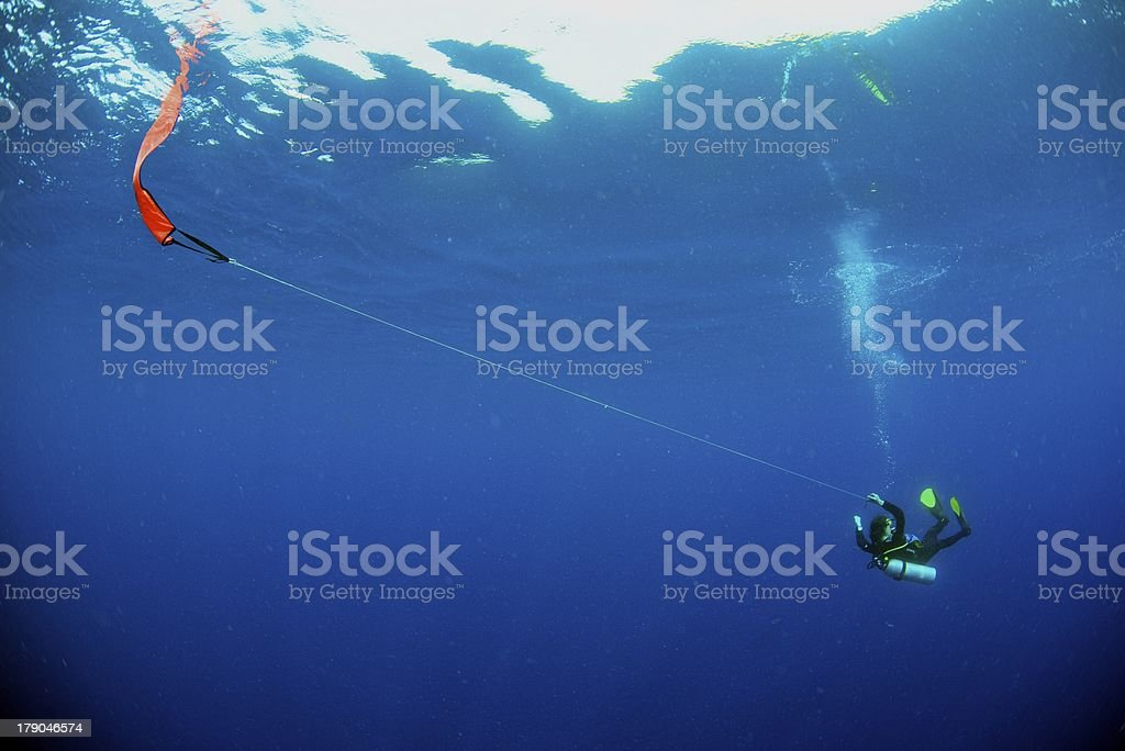 Diver drifting on safety stop stock photo