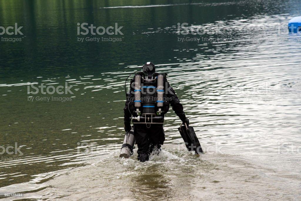 Diver entering the lake in high Alps Austria stock photo