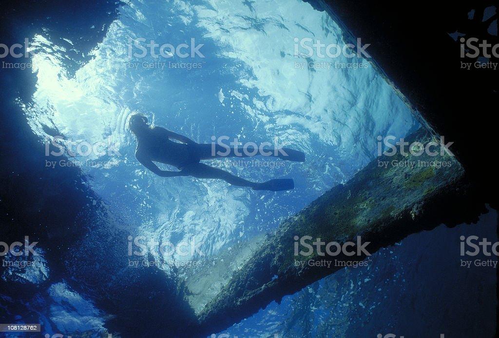 Diver Exploring Shipwreck royalty-free stock photo