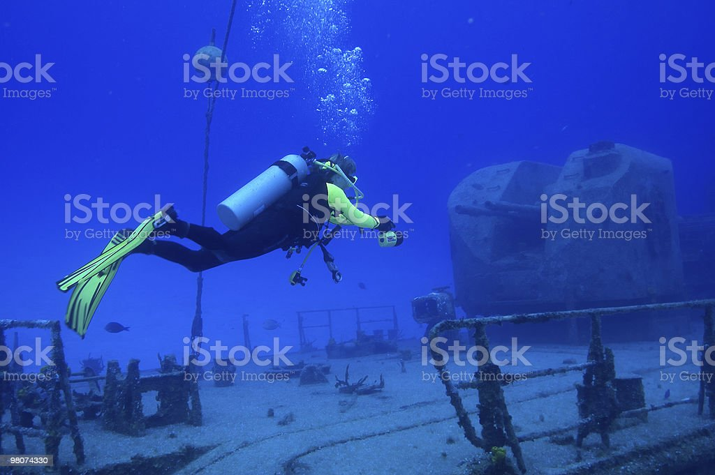 Diver exploring the shipwreck of a Russian warship royalty-free stock photo