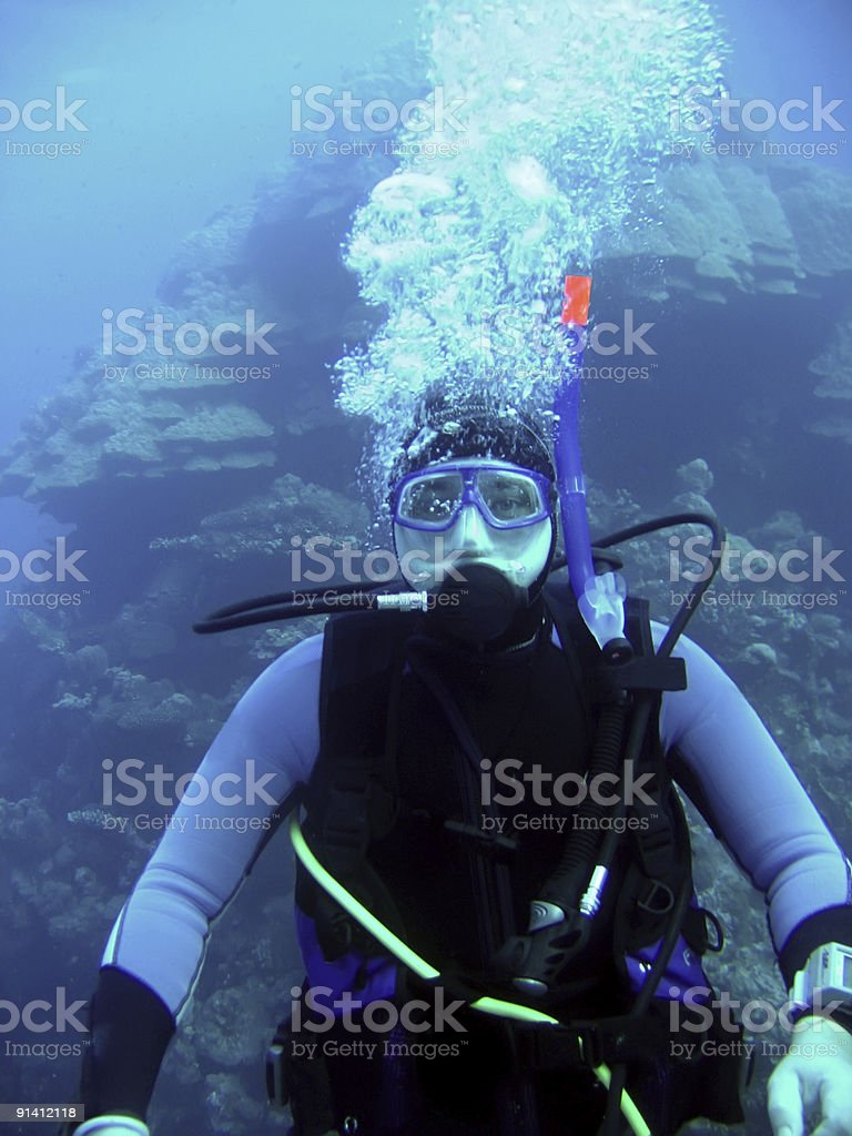 diver in deep royalty-free stock photo