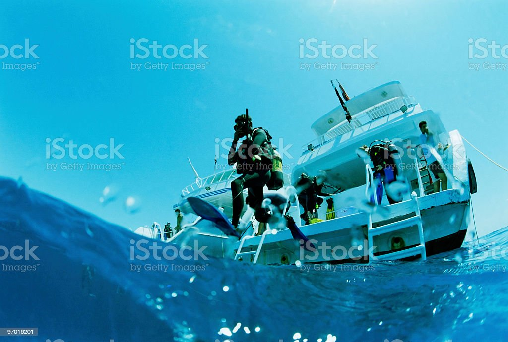 Diver jumping in the water stock photo