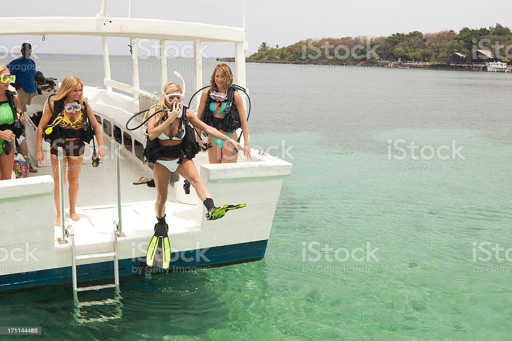 SCUBA Diver jumping off dive boat royalty-free stock photo