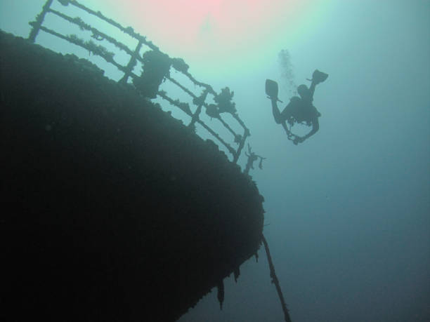 A diver next to the Iona wreck in the Red Sea, off the coast of Yanbu in Saudi Arabia stock photo
