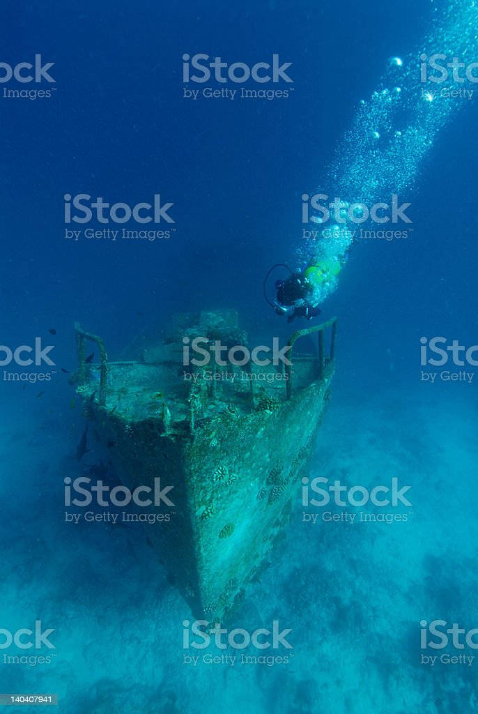 Diver on wreck stock photo