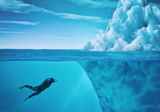 diver swimming - iceberg stock photos and pictures