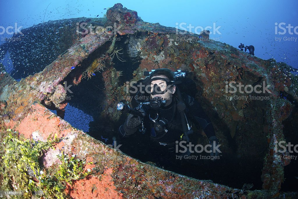 Diver swims through window stock photo