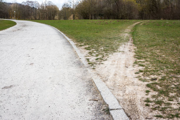 Diverging Path Sidewalk Dirth Path Grass Outdoors Decision Road Less Traveled Diverging Path Sidewalk Dirth Path Grass Outdoors Decision Road Less Traveled narrow stock pictures, royalty-free photos & images