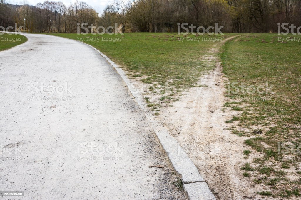 Diverging Path Sidewalk Dirth Path Grass Outdoors Decision Road Less Traveled stock photo