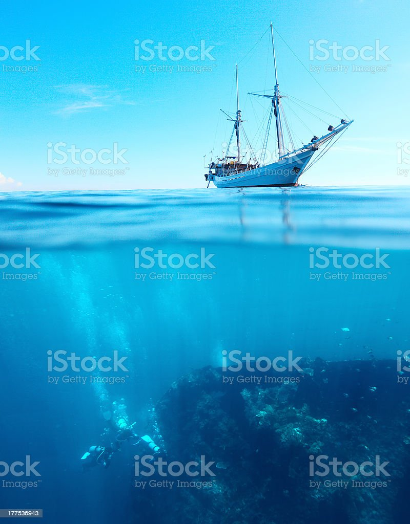 Divers and boat stock photo
