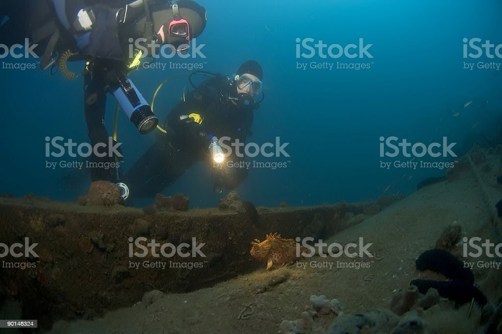 Divers exploring a wreck, Croatia royalty-free stock photo
