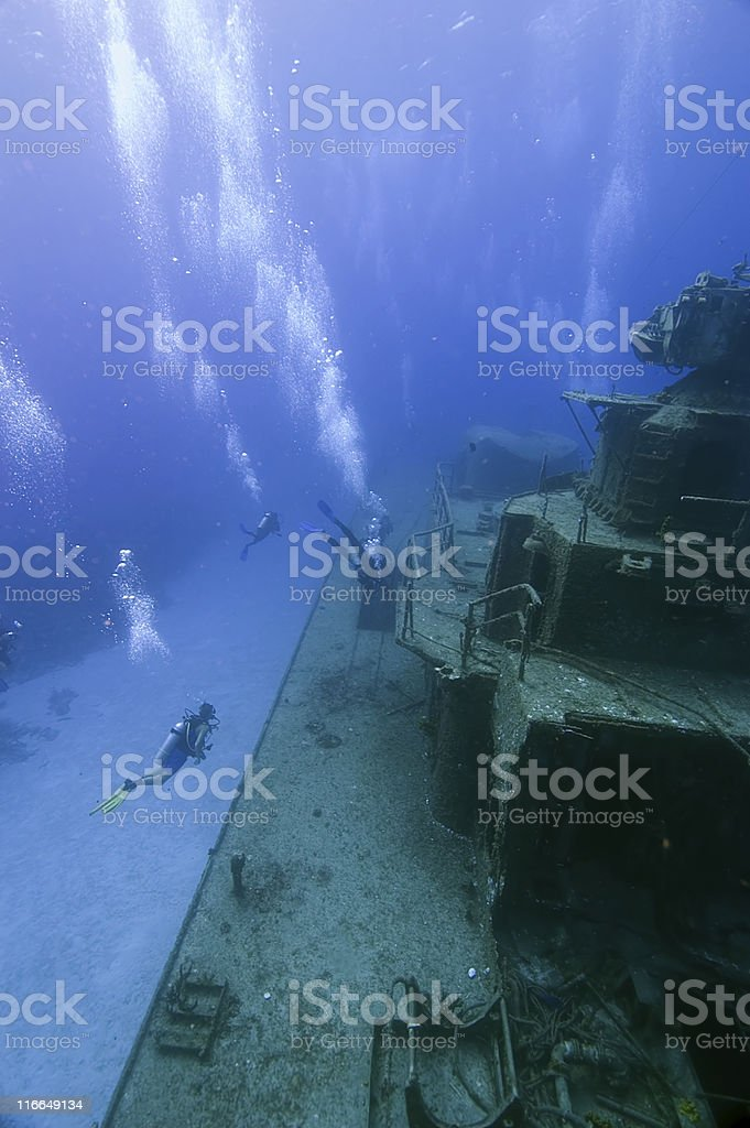 Divers exploring shipwreck royalty-free stock photo