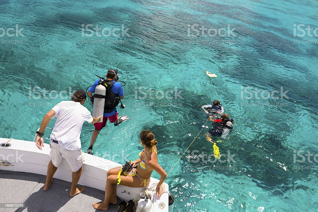 divers getting ready for a diving excursion in the Caribbean stock photo