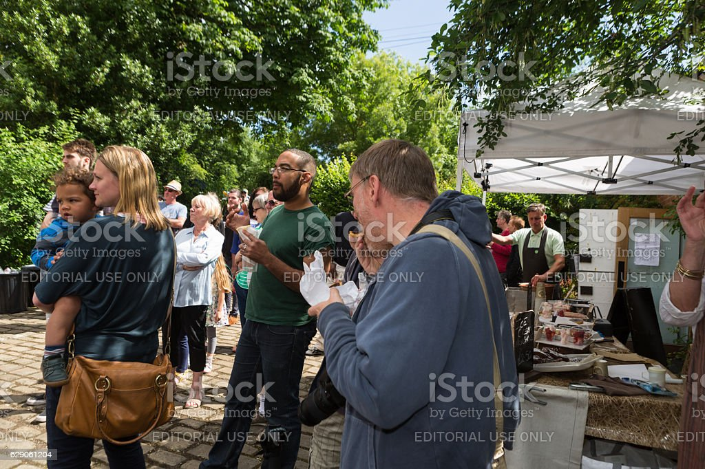 Divers group of people eating at summer event stock photo